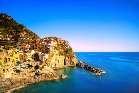 crepuscle: Manarola village on cliff rocks and sea at sunset , Seascape in Five lands, Cinque Terre National Park, Liguria Italy Europe  Square format  Long Exposure