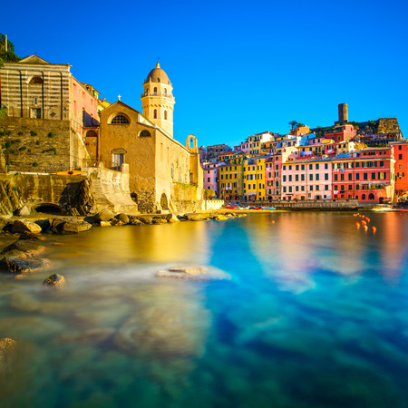 vernazza: Vernazza village, church, rocks and sea harbor on sunset, Seascape in Five lands, Cinque Terre National Park, Liguria Italy Europe  Long Exposure  Stock Photo