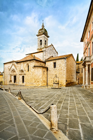 montalcino: Sant Quirico Orcia Collegiata church, medieval square and well  Val d Orcia, Tuscany, Italy, Europe Stock Photo