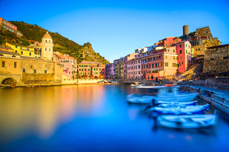 Vernazza village, church, boats and sea harbor on sunset, Seascape in Five lands, Cinque Terre National Park, Liguria Italy Europe  Long Exposure  photo