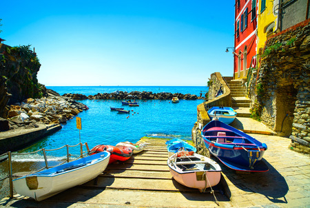 Riomaggiore village street, boats and sea in Five lands, Cinque Terre National Park, Liguria Italy Europe