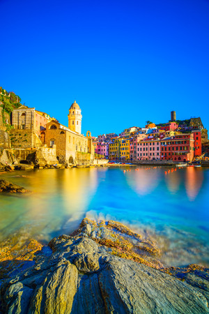 Vernazza village, church, rocks and sea harbor on sunset, Seascape in Five lands, Cinque Terre National Park, Liguria Italy Europe Long Exposure