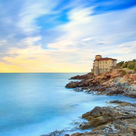 Boccale castle landmark on cliff rock and sea on sunset  Tuscany, Italy, Europe  Long exposure photography