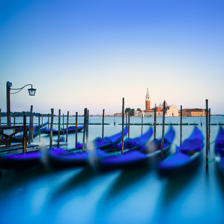Venice, gondolas or gondole on a blue sunset twilight and San Giorgio Maggiore church landmark  photo