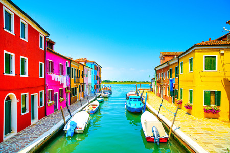 italian village: Venice landmark, Burano island canal, colorful houses and boats, Italy  Long exposure photography Editorial