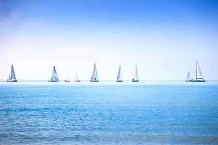 Sailing boat yacht or sailboat group regatta race on sea or ocean water  Panoramic view