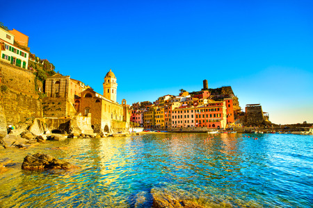 cinque: Vernazza village, church, rocks and sea harbor on sunset, Seascape in Five lands, Cinque Terre National Park, Liguria Italy Europe