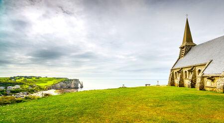 garde: Etretat village, Church Notre Dame de la Garde chapel and Aval cliff. Normandy, France, Europe.