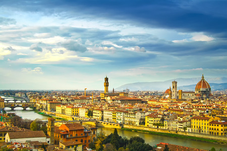 firenze: Florence sunset aerial cityscape. Panorama view from Michelangelo park square. From left Palazzo Vecchio and Duomo Cathedral. Italy