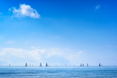 Sailing boat yacht or sailboat group regatta race on sea or ocean water. Panoramic view. photo
