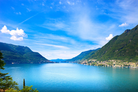 Como Lake landscape. Cernobbio village, trees, water and mountains. Italy, Europe.