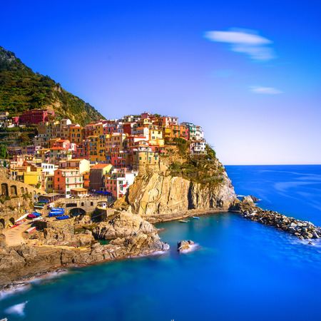 cinque: Manarola village on cliff rocks and sea at sunset., Seascape in Five lands, Cinque Terre National Park, Liguria Italy Europe. Square format. Long Exposure
