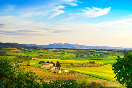 Maremma, rural sunset landscape. Countryside farmland and green fields. Tuscany, Italy, Europe.