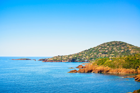 d���azur: Agay in Esterel mediterranean red rocks coast, beach and sea. French Riviera in Cote d Azur near Cannes, Provence, France, Europe.