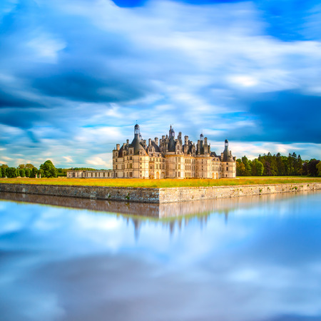 chambord: Chateau de Chambord, royal medieval french castle and reflection. Loire Valley, France, Europe. Unesco heritage site. Long exposure.