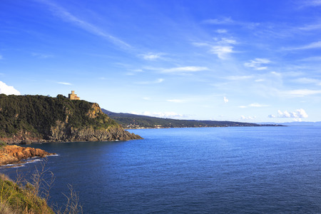 Cliff rock and building on the sea on sunset. Quercianella coast, Tuscany riviera, Italy, Europe. photo
