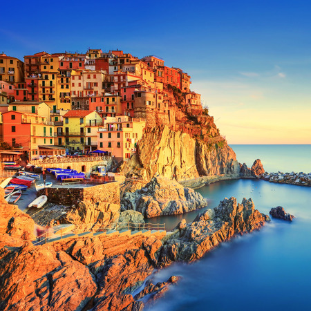Manarola village on cliff rocks and sea at sunset., Seascape in Five lands, Cinque Terre National Park, Liguria Italy Europe. Square format. Long Exposure