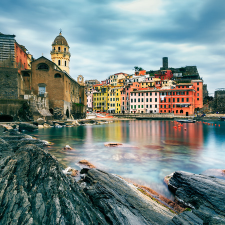 vernazza: Vernazza village, church, rocks and sea harbor on sunset, Seascape in Five lands, Cinque Terre National Park, Liguria Italy Europe. Long Exposure.