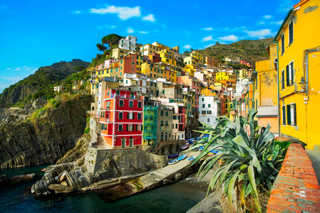 Riomaggiore village on cliff rocks and sea at sunset., Seascape in Five lands, Cinque Terre National Park, Liguria Italy Europe. Long Exposure