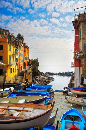 cinque: Riomaggiore village street, boats and sea in Five lands, Cinque Terre National Park, Liguria Italy Europe. long exposure Stock Photo