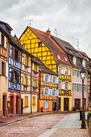 Colmar, Petit Venice, street, lamp and traditional half-timbered houses colorful. Alsace, France. photo