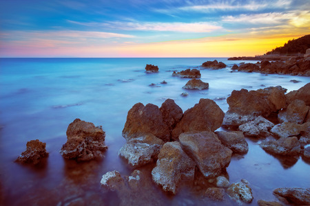 crepuscle: Castiglioncello travel destination rock and sea on sunset. Tuscany, Italy, Europe. Long Exposure