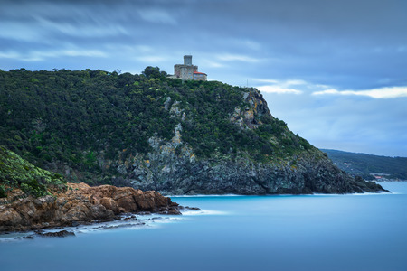 leghorn: Cliff rock and building on the sea on winter. Quercianella Tuscany riviera Italy Europe. Long Exposure