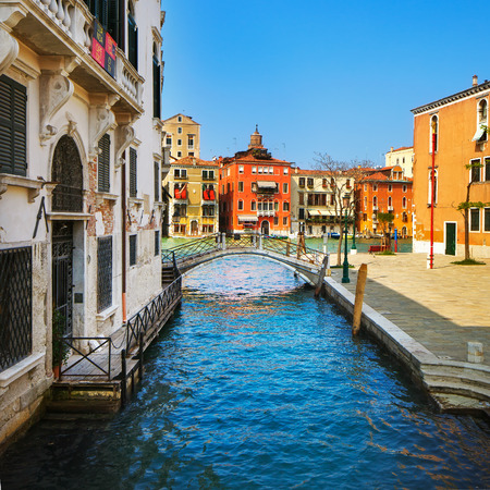 Venice cityscape in Campo San Vio square bridge tree and traditional buildings on water grand canal. Italy Europe.