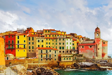 cinque: Tellaro rocks and old village on the sea. Church and houses. Five lands Cinque Terre Liguria Italy Europe. Stock Photo