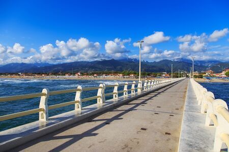promenade: Pier footpath promenade beach and Apuane mountains in Forte dei Marmi Versilia Tuscany Italy