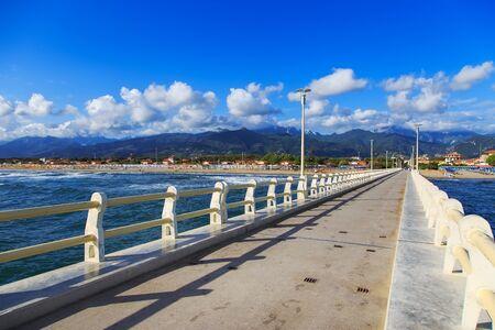 forte: Pier footpath promenade beach and Apuane mountains in Forte dei Marmi Versilia Tuscany Italy