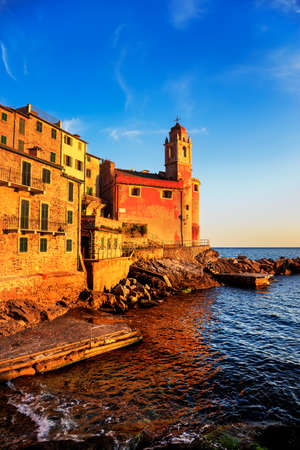 sea of houses: Tellaro rocks and old village on the sea. Church and houses on sunset. Five lands, Cinque Terre, Liguria Italy Europe.