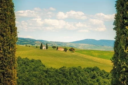 val d      orcia: Tuscany, italian rural landscape, cypress trees Vitaleta chapel on background, little church in Val d Orcia, Italy Stock Photo