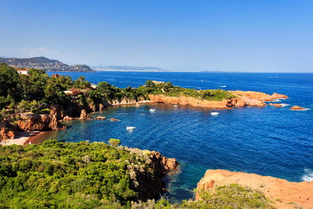 azure coast: Esterel mediterranean red rocks coast, beach and sea. French Riviera in Cote d Azur near Cannes, Provence, France, Europe. Stock Photo