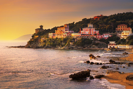 europe: Castiglioncello sunset on cliff rock and sea. Tuscany, Italy, Europe Stock Photo