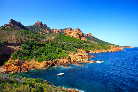 Esterel mediterranean red rocks coast, beach and sea. French Riviera in Cote d Azur near Cannes Saint Raphael, Provence, France, Europe.