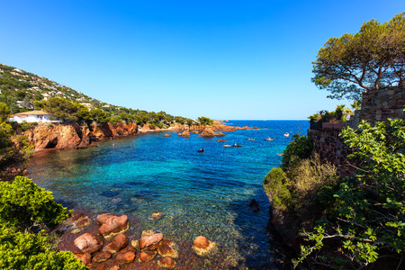 mediterranean houses: Esterel mediterranean red rocks coast, beach and sea. French Riviera in Cote d Azur near Saint Raphael, Provence, France, Europe. Stock Photo