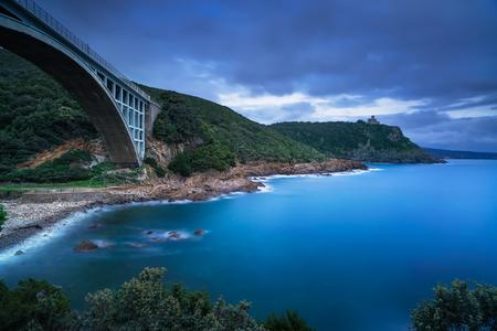 leghorn: Bridge, cliff and sea. Leghorn coast, Tuscany riviera, Italy, Europe. Long Exposure.