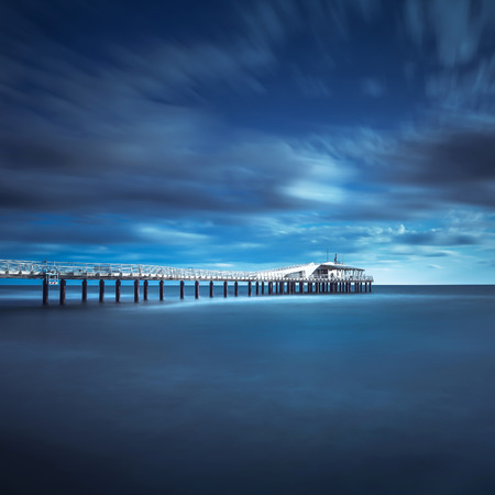 lido: Modern steel pier in a cold atmosphere Long exposure photography in Lido Camaiore, Versilia, Tuscany, Italy, Europe