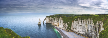 Etretat Aval cliff, rocks and natural arch landmark and blue ocean. Aerial view. Normandy, France, Europe. Foto de archivo