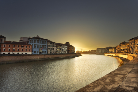 crepuscle: Pisa, Arno river sunset. Lungarno view. Tuscany, Italy, Europe
