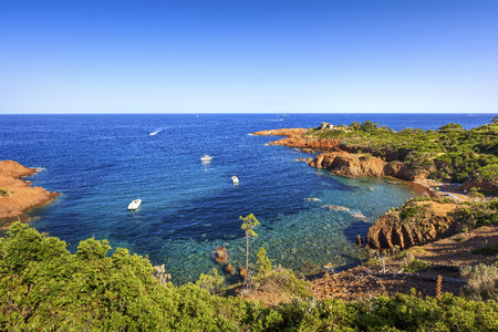 provencal: Esterel mediterranean red rocks coast, beach and sea. French Riviera in Cote d Azur near Cannes, Provence, France, Europe. Stock Photo