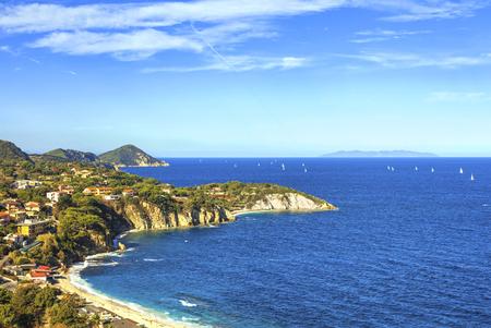 clear sky: Elba island, Portoferraio Sansone white beach coast. Tuscany, Italy, Europe. Long Exposure. Stock Photo