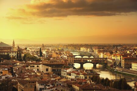 firenze: Florence or Firenze sunset Ponte Vecchio bridge. Panorama view from Michelangelo park square. Tuscany, Italy