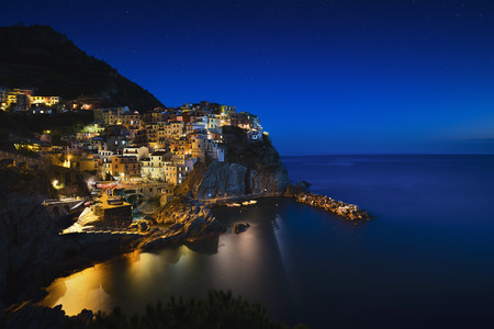 seascape: Manarola starring night. Village on cliff rocks and sea. Seascape in Five lands, Cinque Terre National Park, Liguria Italy Europe.