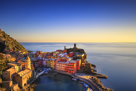 vernazza: Vernazza village, aerial view on red sunset, Seascape in Five lands, Cinque Terre National Park, Liguria Italy Europe. Long Exposure. Stock Photo