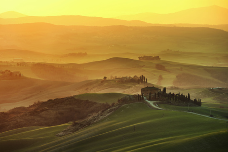 volterra: Tuscany spring, rolling hills on misty sunset. Rural landscape. Green fields and farmlands. Italy, Europe
