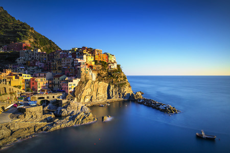 seascape: Manarola village on cliff rocks and sea at sunset., Seascape in Five lands, Cinque Terre National Park, Liguria Italy Europe. Long Exposure