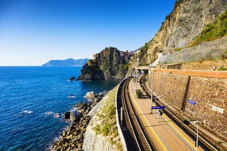 cinque terre: Manarola village, train or railroad station rock and sea.  Five lands, Cinque Terre National Park, Liguria Italy Europe.
