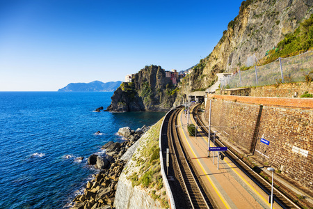 Manarola village, train or railroad station rock and sea.  Five lands, Cinque Terre National Park, Liguria Italy Europe.